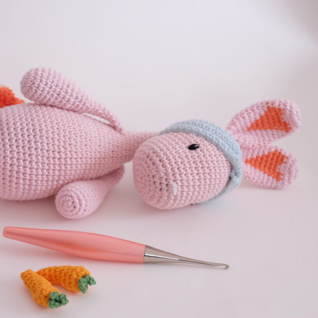 Crochet bunny with a crochet hook